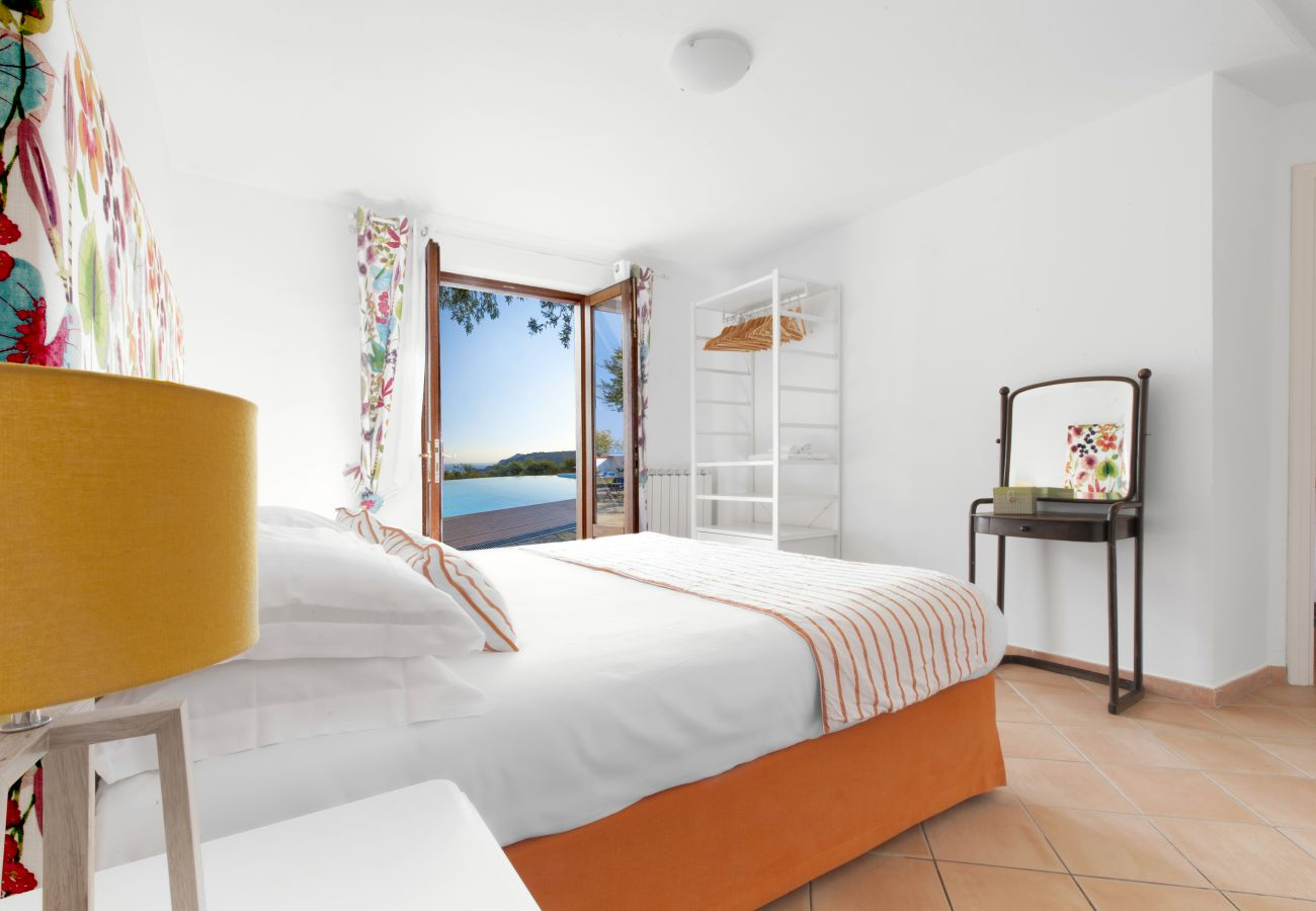 bright orange double bedroom, villa chez piè, vacation villa massa lubrense, italy