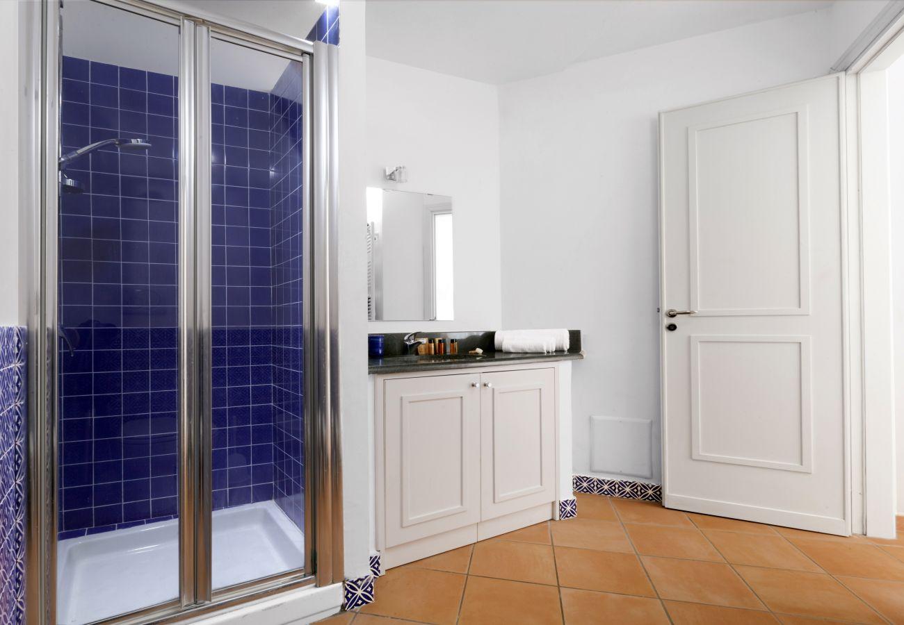 bathroom with blue shower cabin , villa chez piè, vacation villa massa lubrense, italy