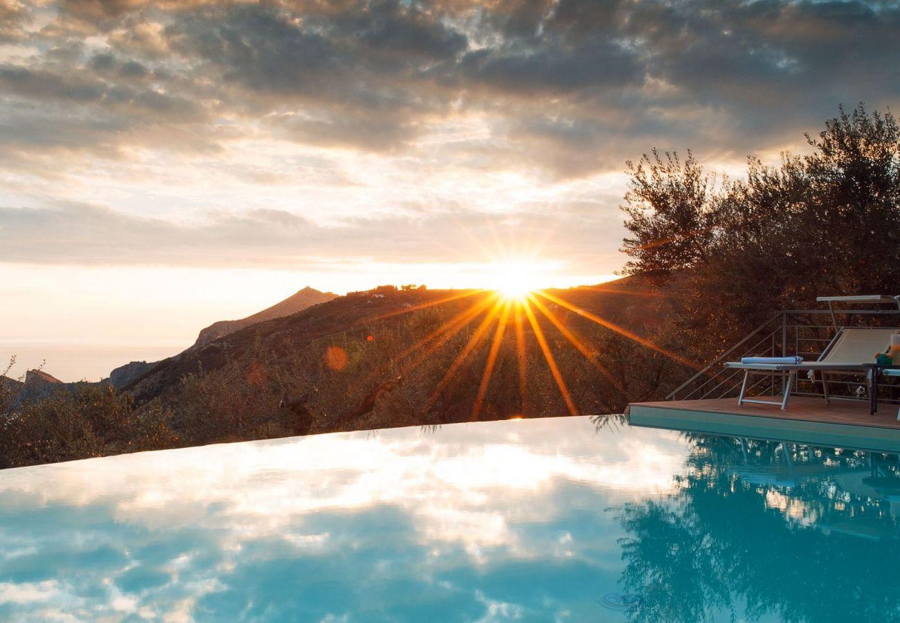 sunset view from infinity pool villa chez piè, sorrento coast, italy