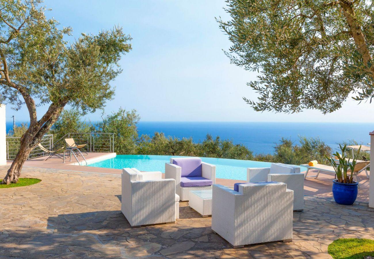 infinity pool terrace with sofas, villa chez piè, vacation villa massa lubrense, italy