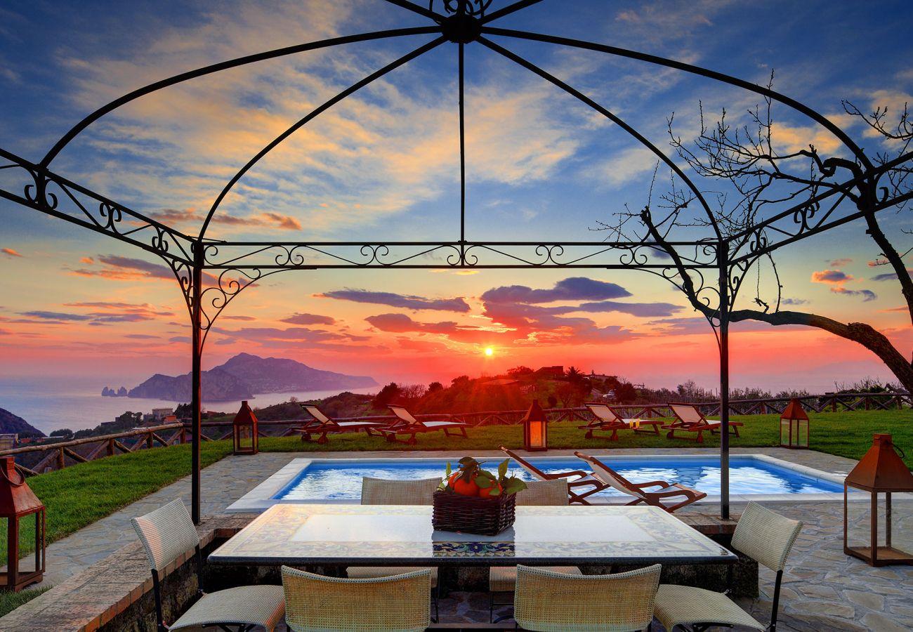 gorgeous sunset on capri island, pool solarium view from casa del capitano, vacation villa massa lubrense, italy
