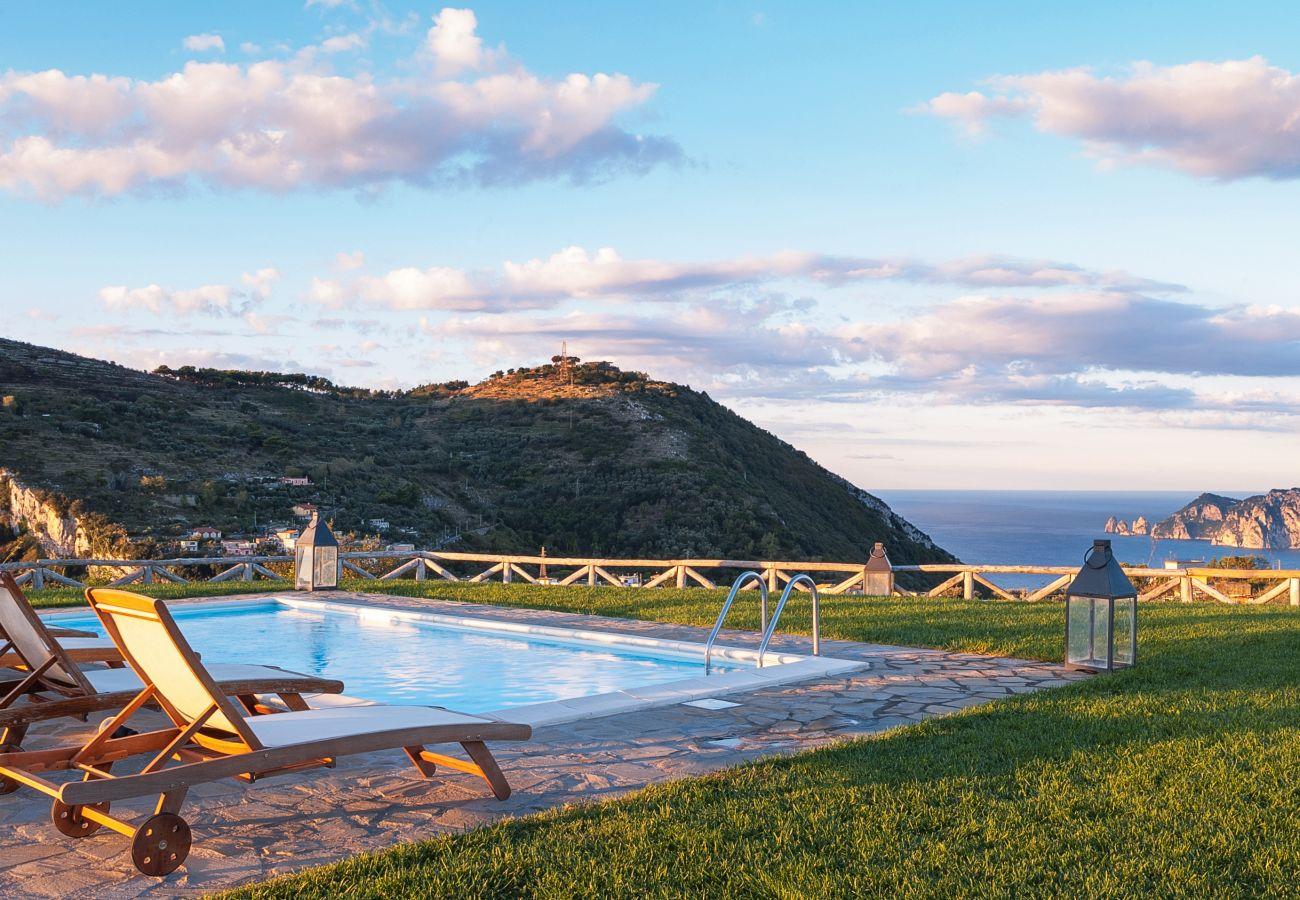 casa del capitano pool with view on san costanzo muntain, vacation villa massa lubrense, italy