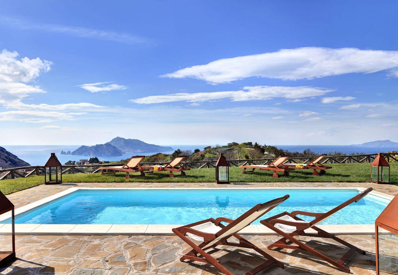 pool with solarium and garden, amazing view of capri island, casa del capitano, vacation villa massa lubrense, italy