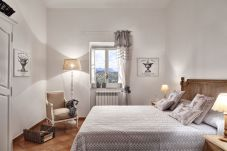 double bedroom with window and lights on, casa del capitano, vacation villa massa lubrense, italy