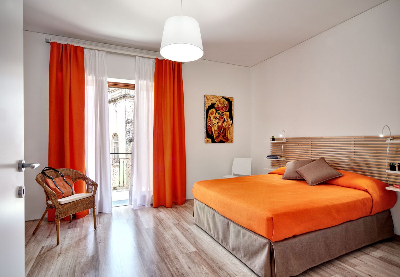 bright double bedroom with balcony and orange blanket, holiday home crawford