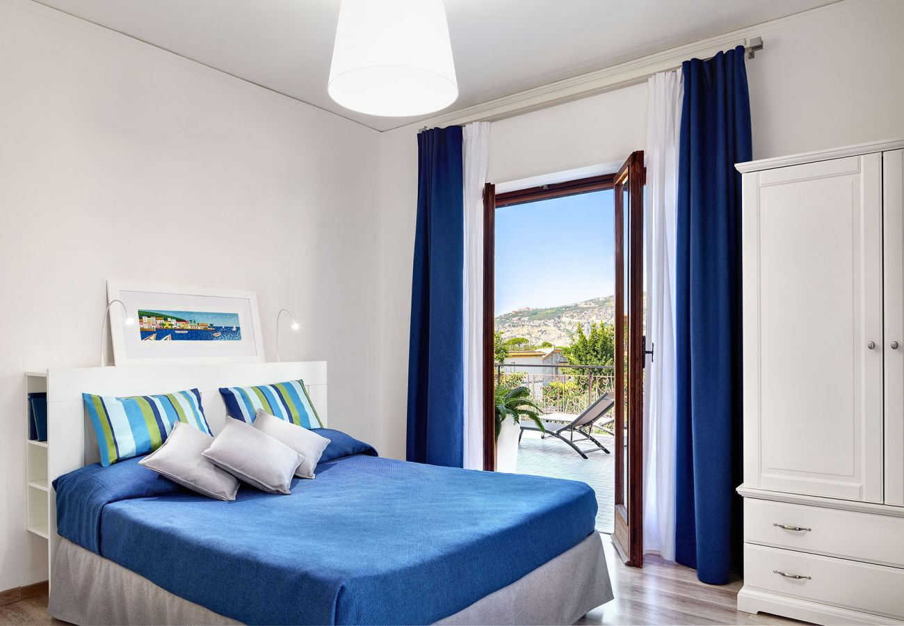 blue double bedroom with terrace access, casa crawford sorrento
