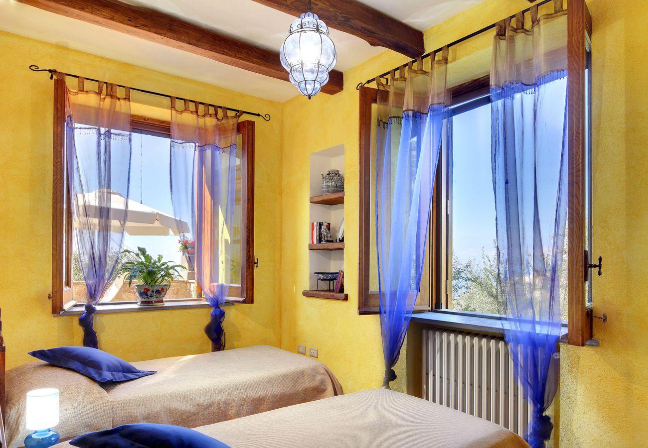 bright twin bedroom, primula apartment, casale la torre residence, massa lubrense, italy