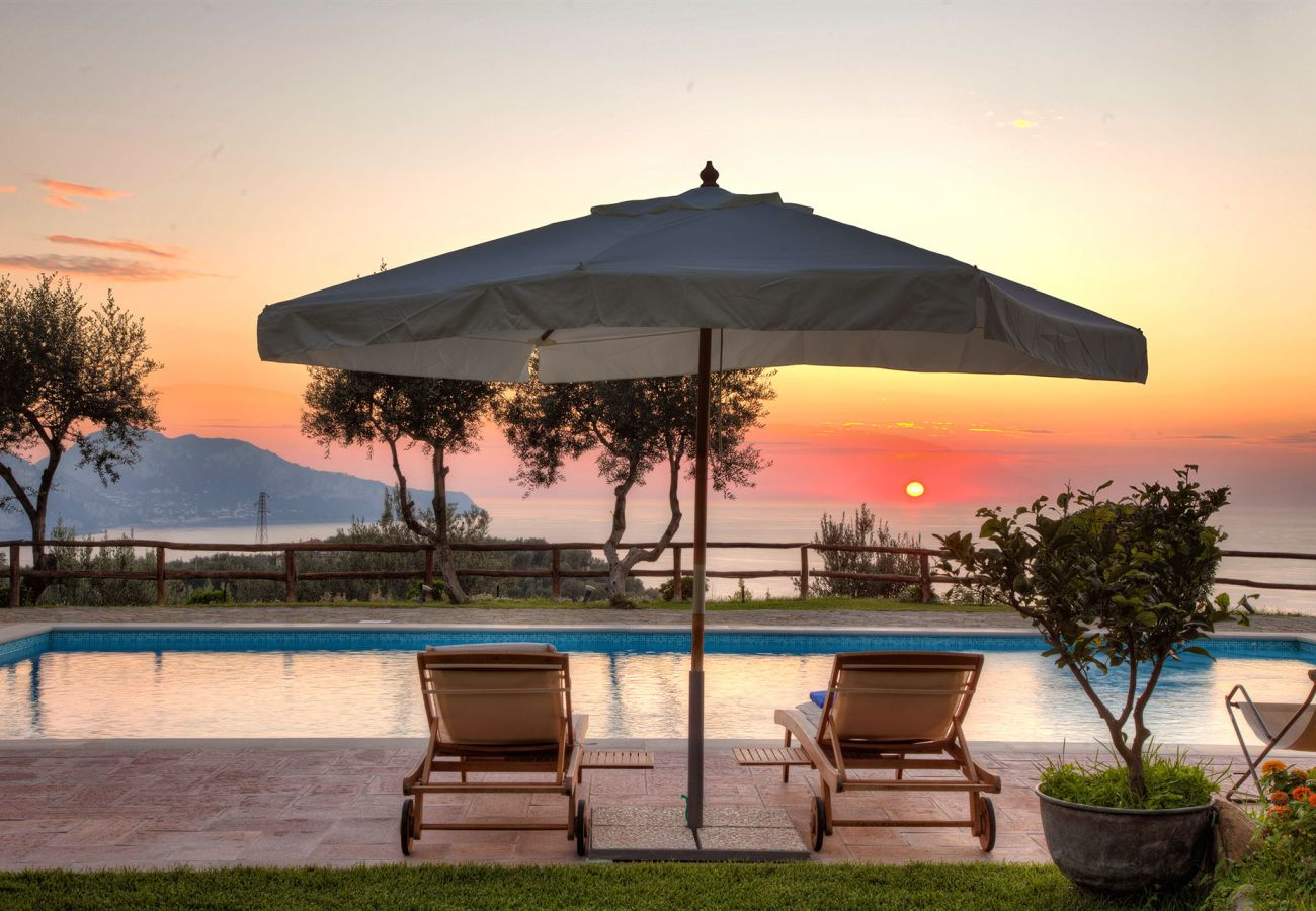 sunset on capri island from the pool, casale la torre, holiday apartments near sorrento, massa lubrense, italy
