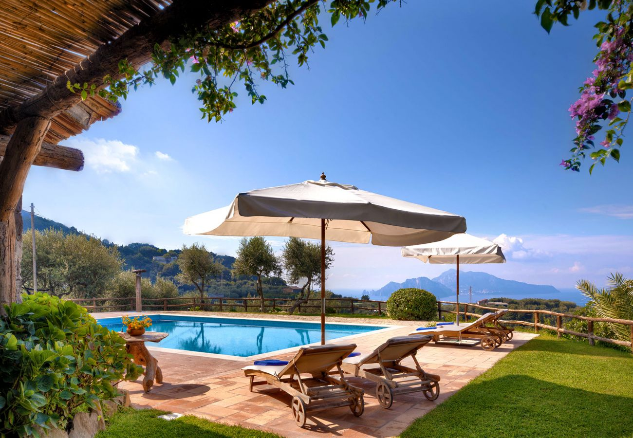 panoramic seaview pool with sunbeds and umbrellas, casale la torre, massa lubrense, italy