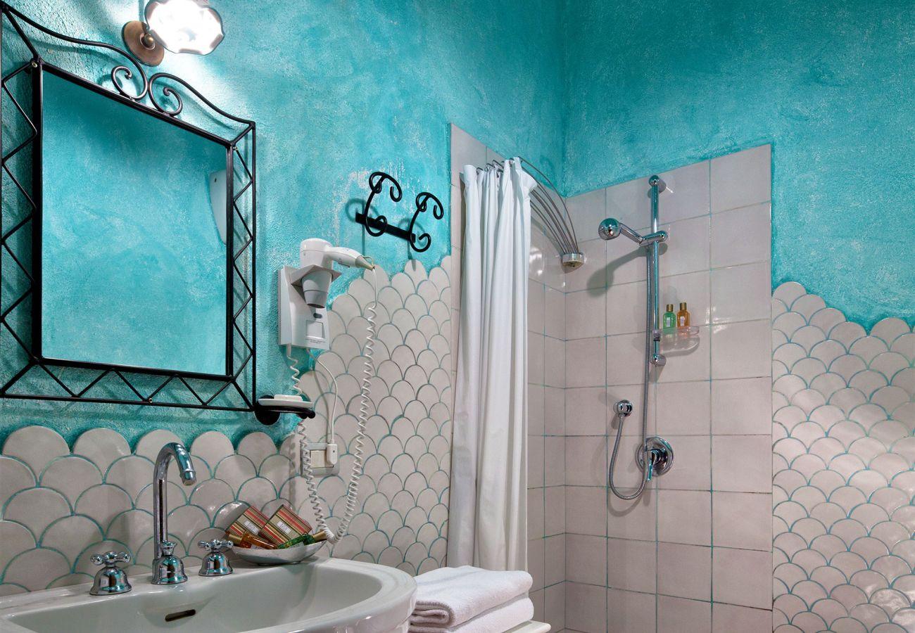 blue bathroom corallo apartment