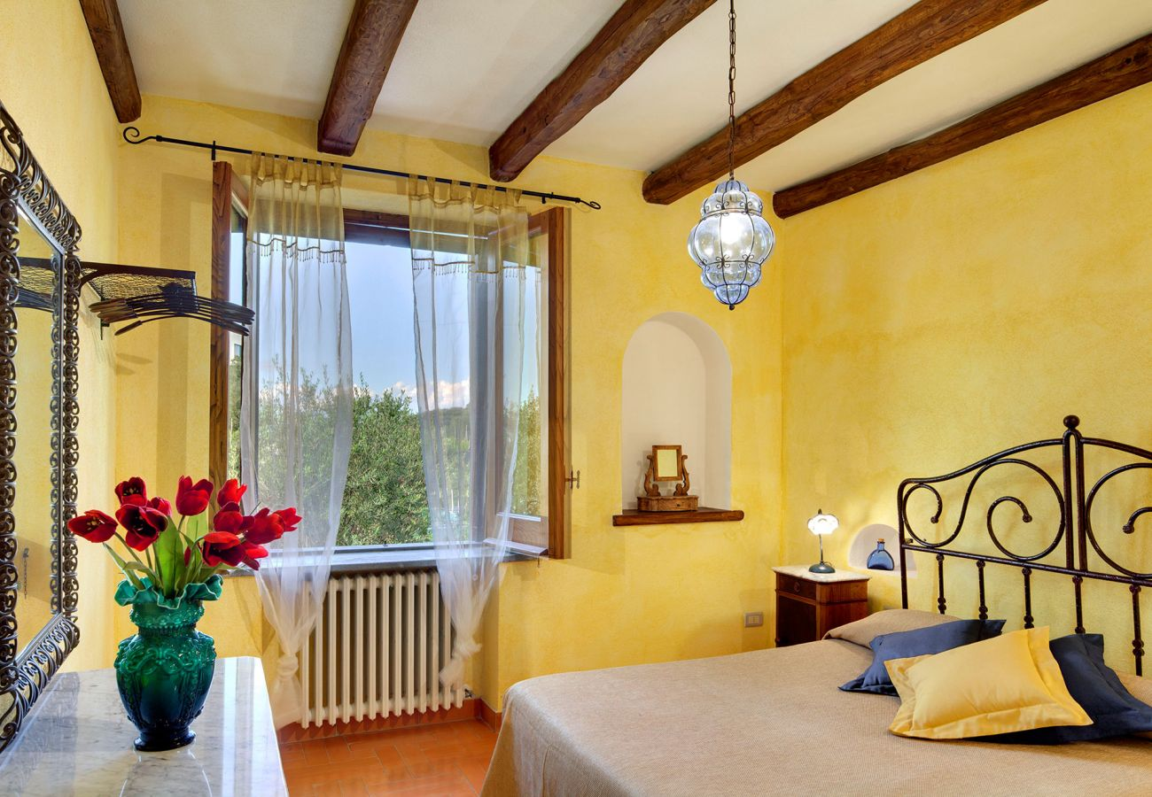double bedroom with wide window, casale la torre, holiday apartments near sorrento, massa lubrense, italy