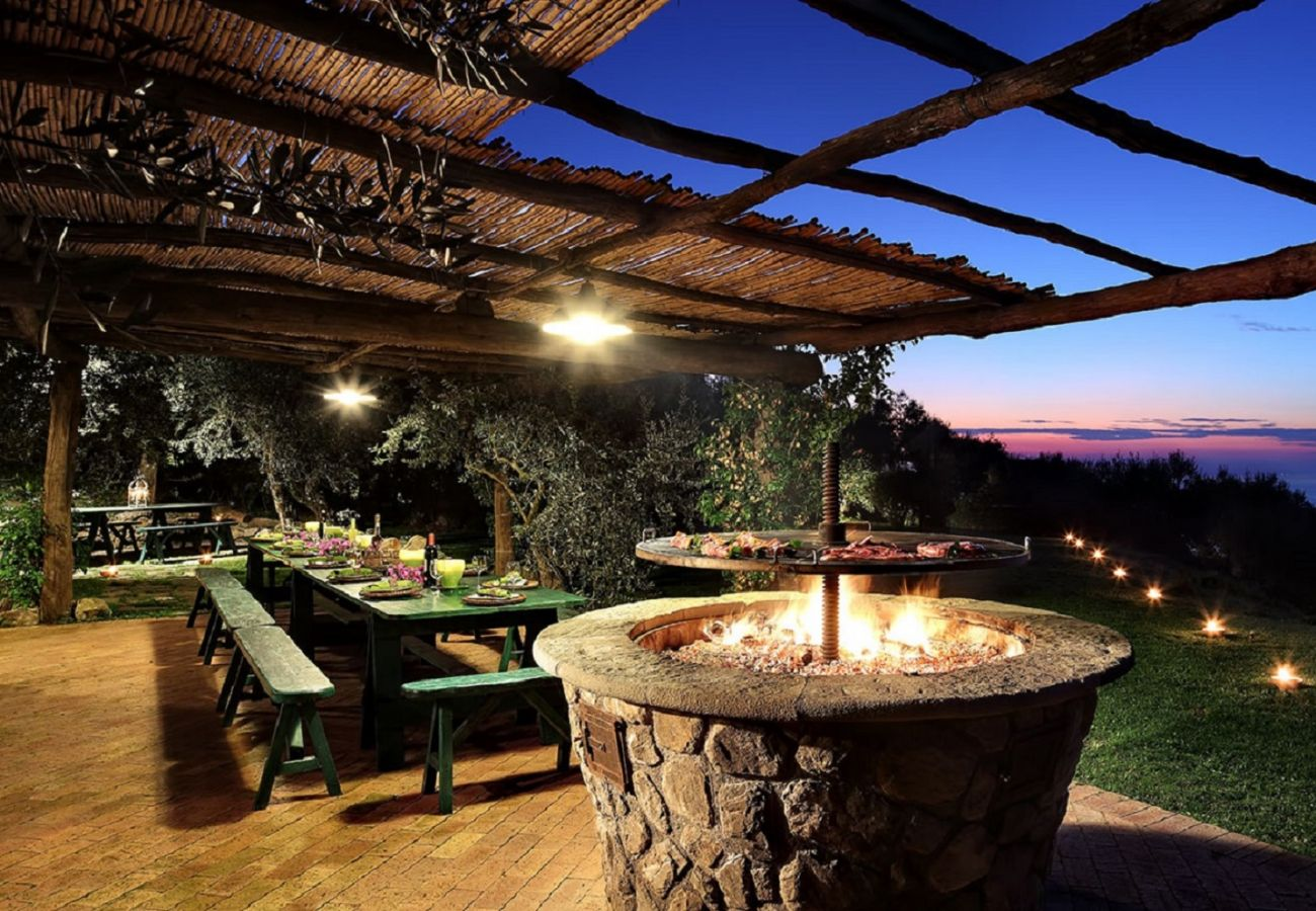 bbq and picnic area at sunset, casale la torre, holiday apartments near sorrento, massa lubrense, italy
