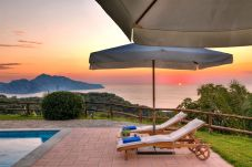 stunning view of capri island at sunset from pool terrace casale la torre, holiday apartments, massa lubrense, italy