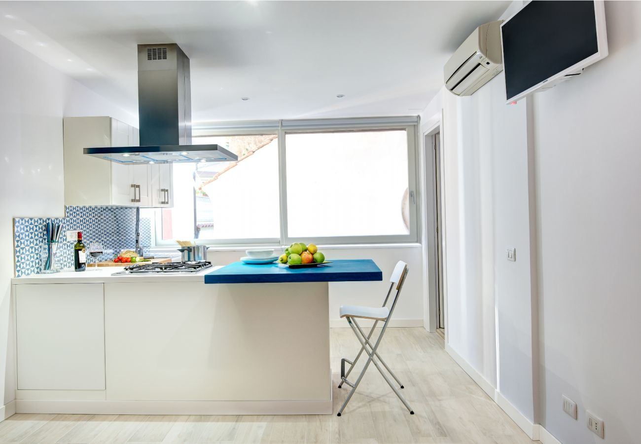 modern bright kitchen with tv, balconcino holiday apartment sorrento, italy