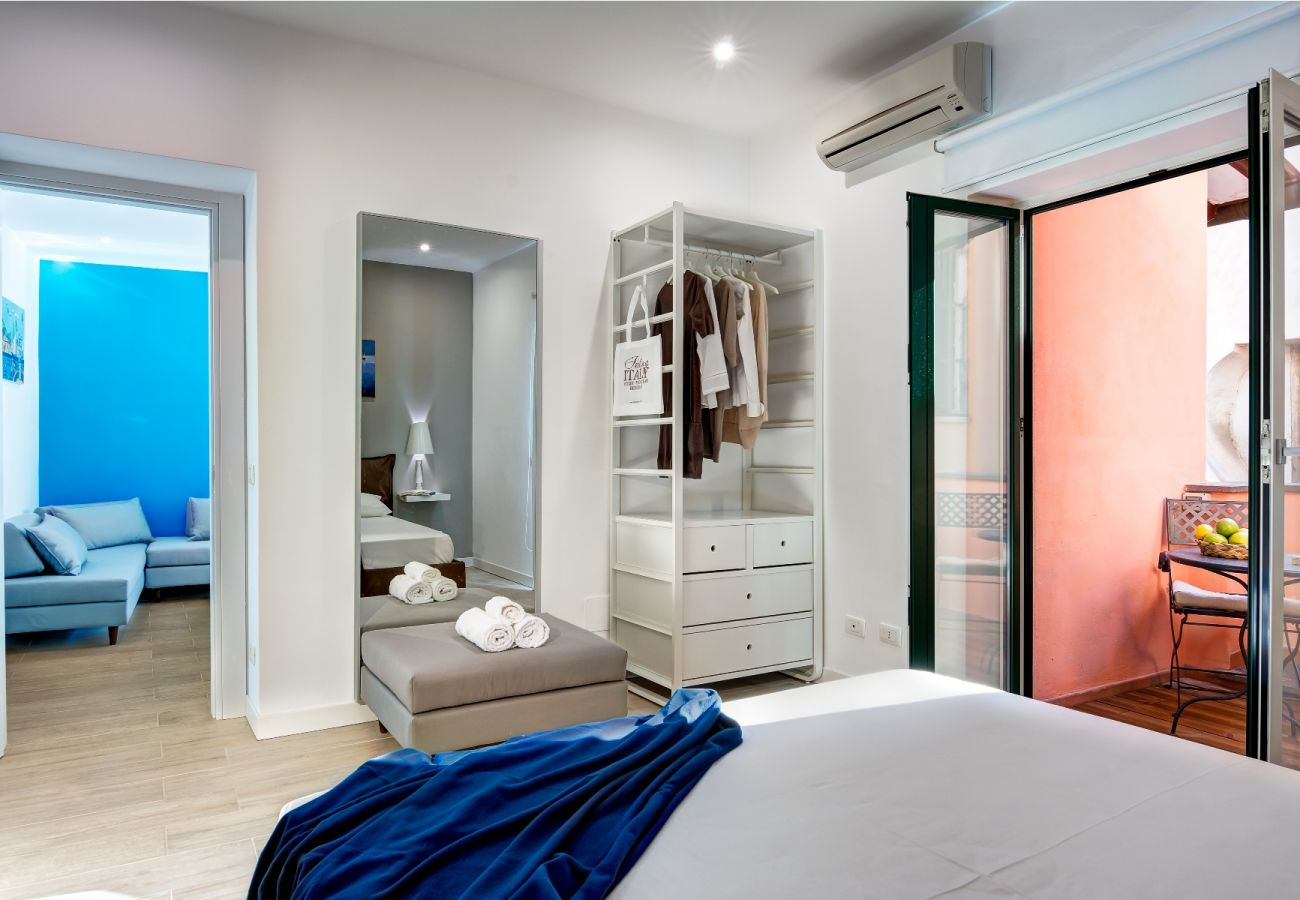 double bedroom with balcony and air conditioner, balconcino holiday apartment sorrento, italy