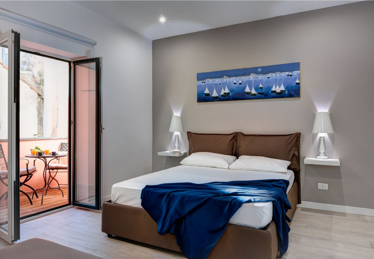 modern double bedroom with opened balcony, balconcino holiday apartment sorrento, italy