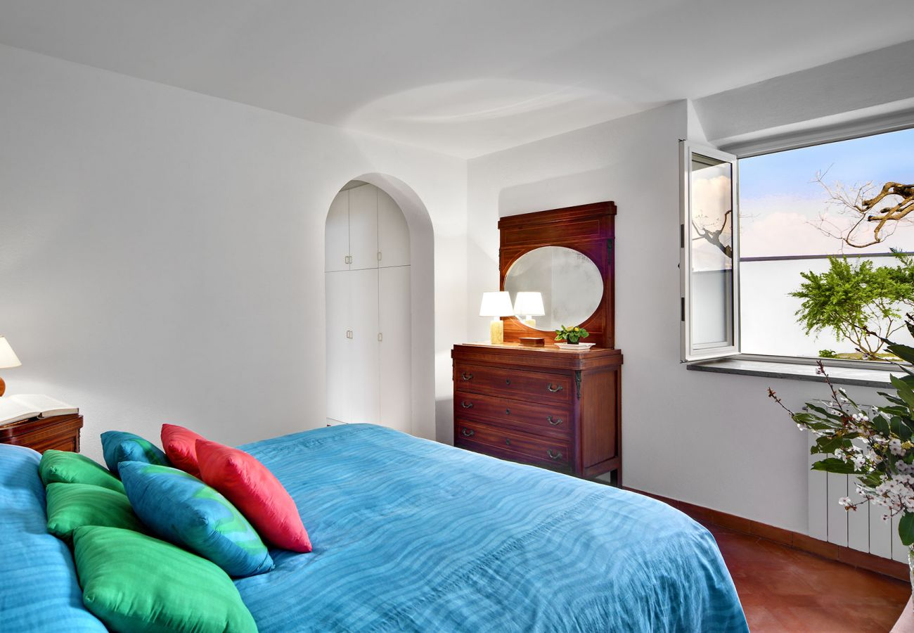 double bedroom with opened window, villa il gioiello, sorrento, italy