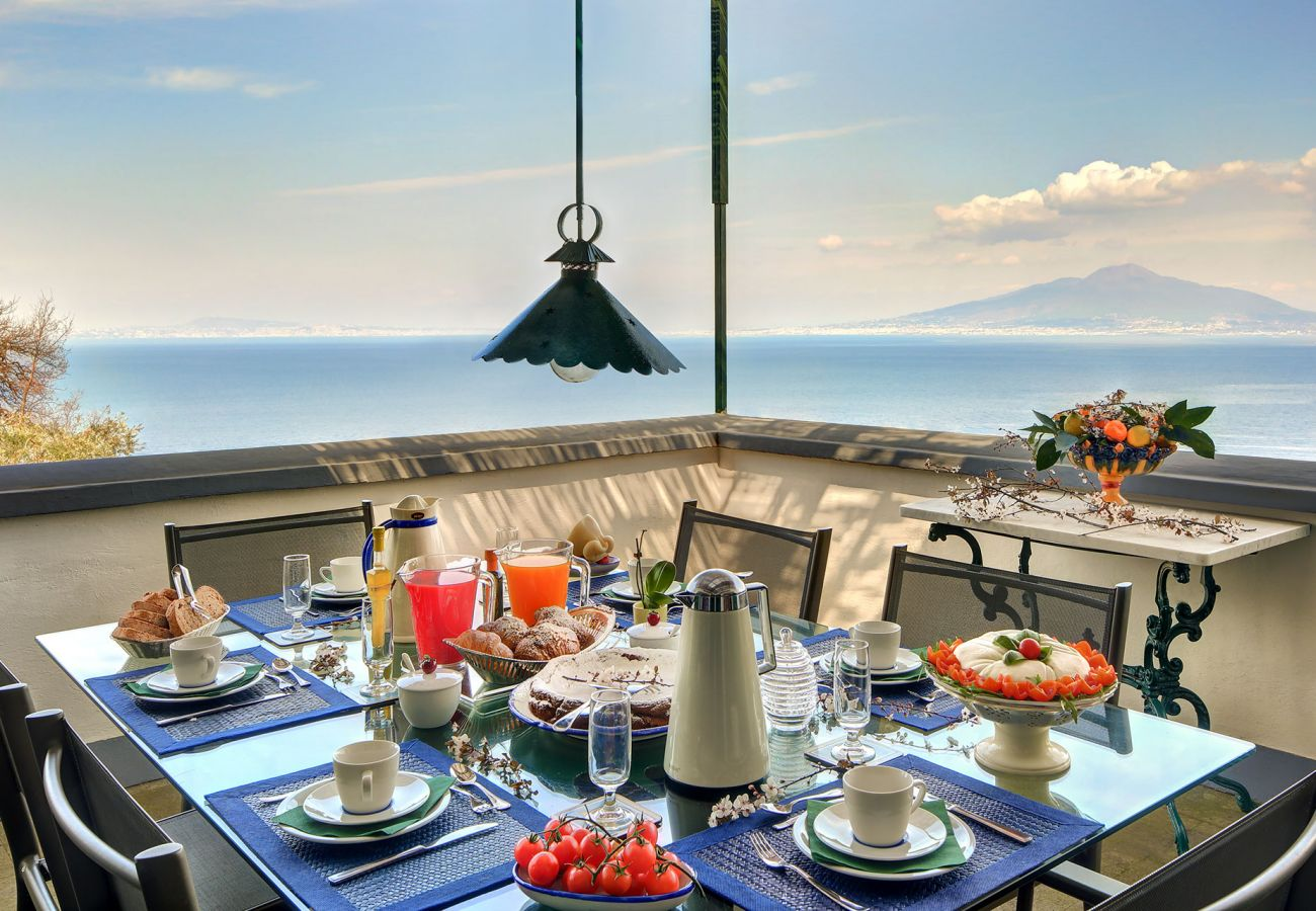panoramic seaview terrace with table and chairs, villa il gioiello, sorrento, italy
