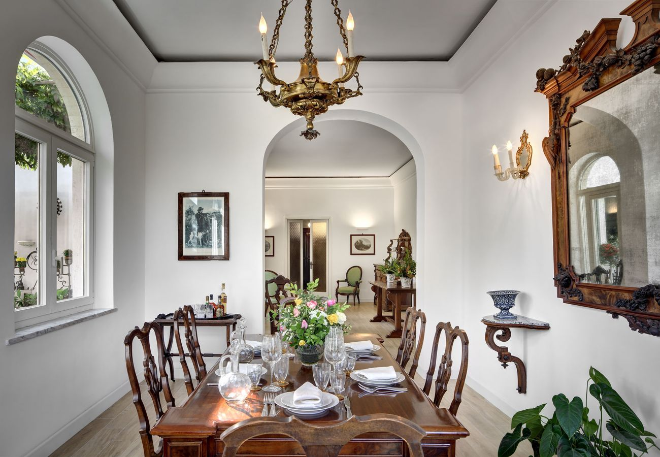 bright dining room with table and chairs, vacation villa la casa bianca, massa lubrense, italy