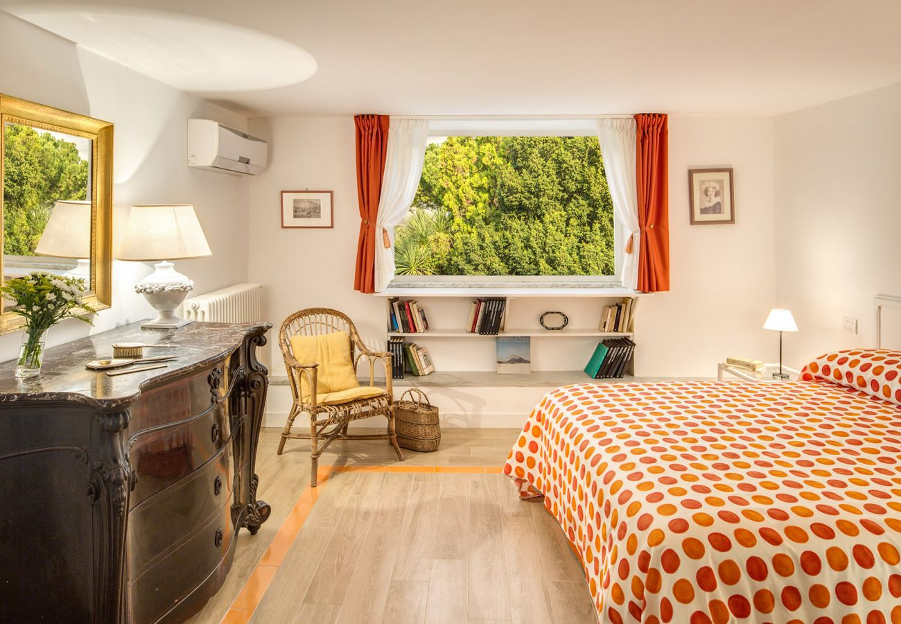 double bedroom with two panoramic windows, vacation villa la casa bianca, massa lubrense, italy