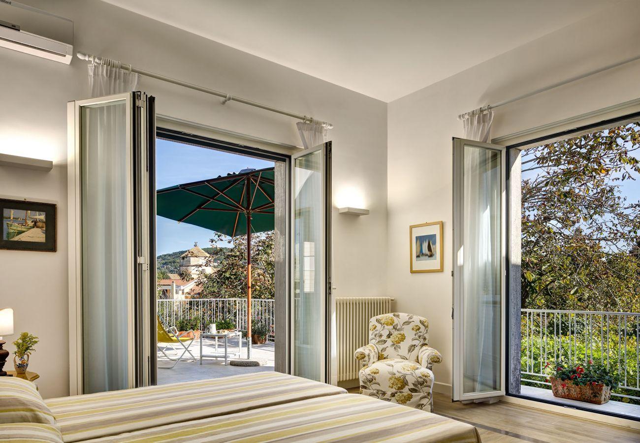 panoramic double bedroom, two opened balconies, vacation villa la casa bianca, massa lubrense, italy
