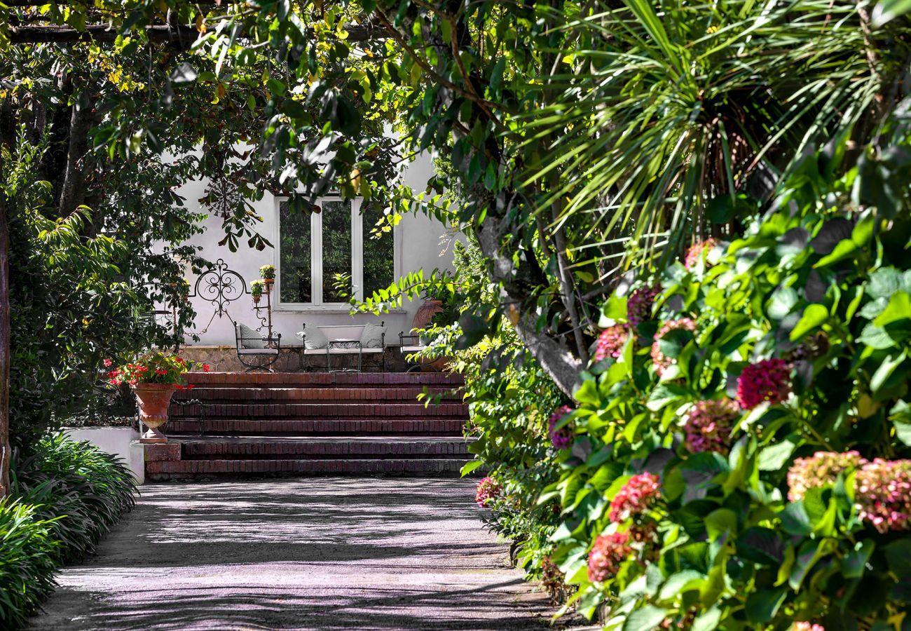 entrance, by the garden, to the vacation villa la casa bianca, massa lubrense, italy