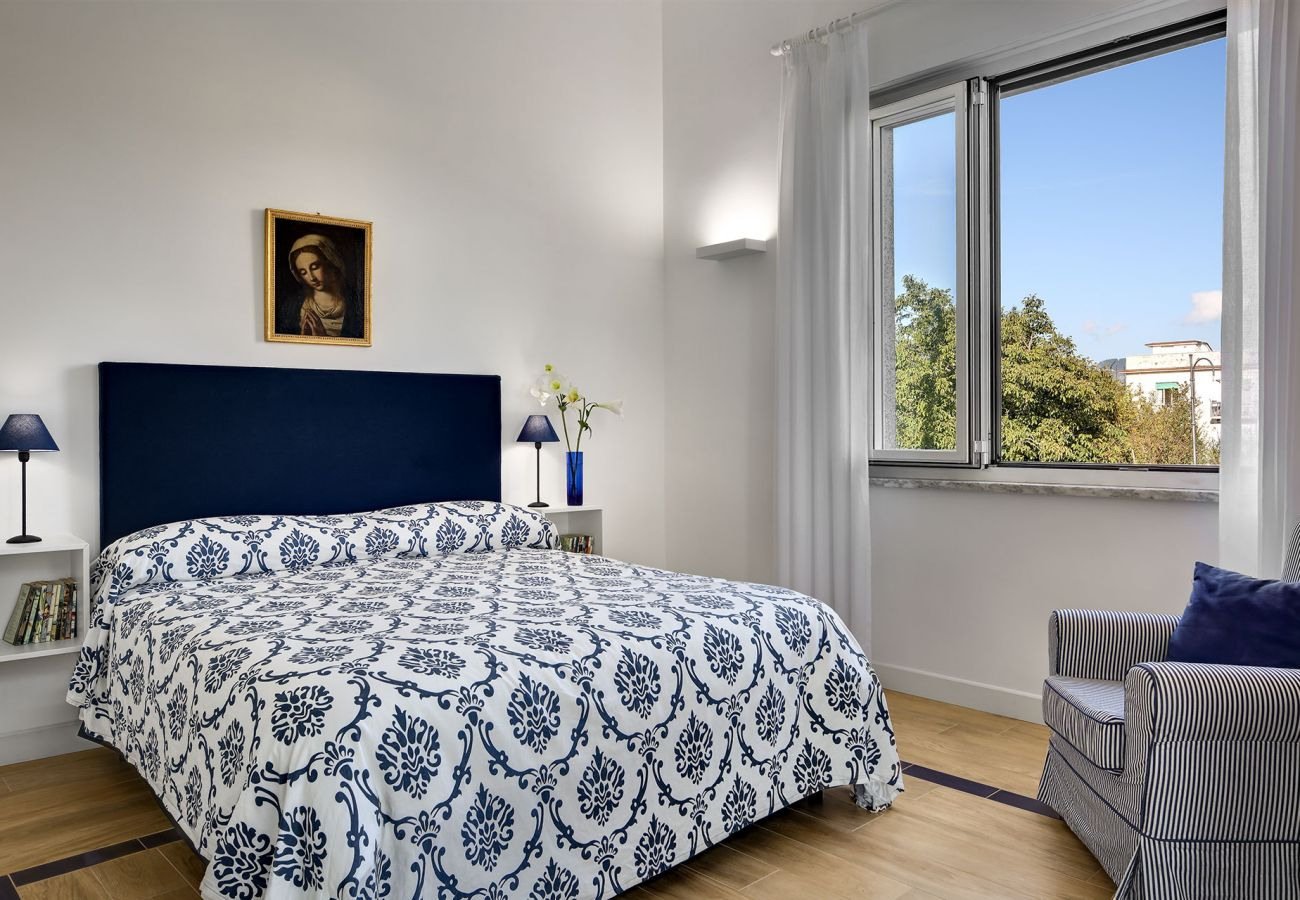 bright double bedroom with opened panoramic window, vacation villa la casa bianca, massa lubrense, italy
