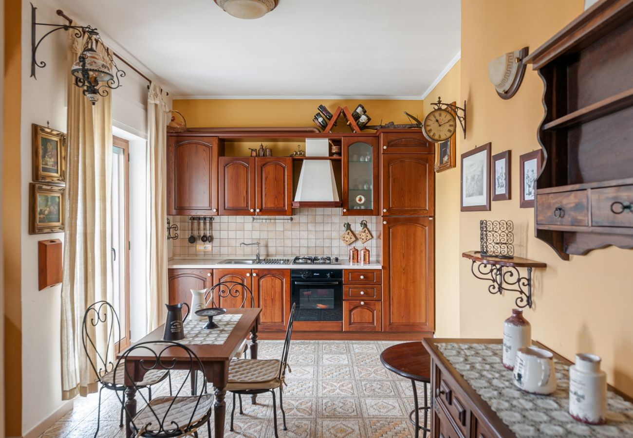 wide kitchen, wood furniture, fully kitchen, la musica holiday apartment sorrento city center, italy