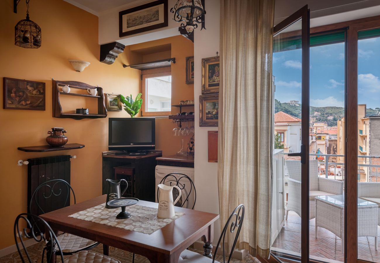 dining room with panoramic and furnished balcony, la musica holiday apartment sorrento city center, italy