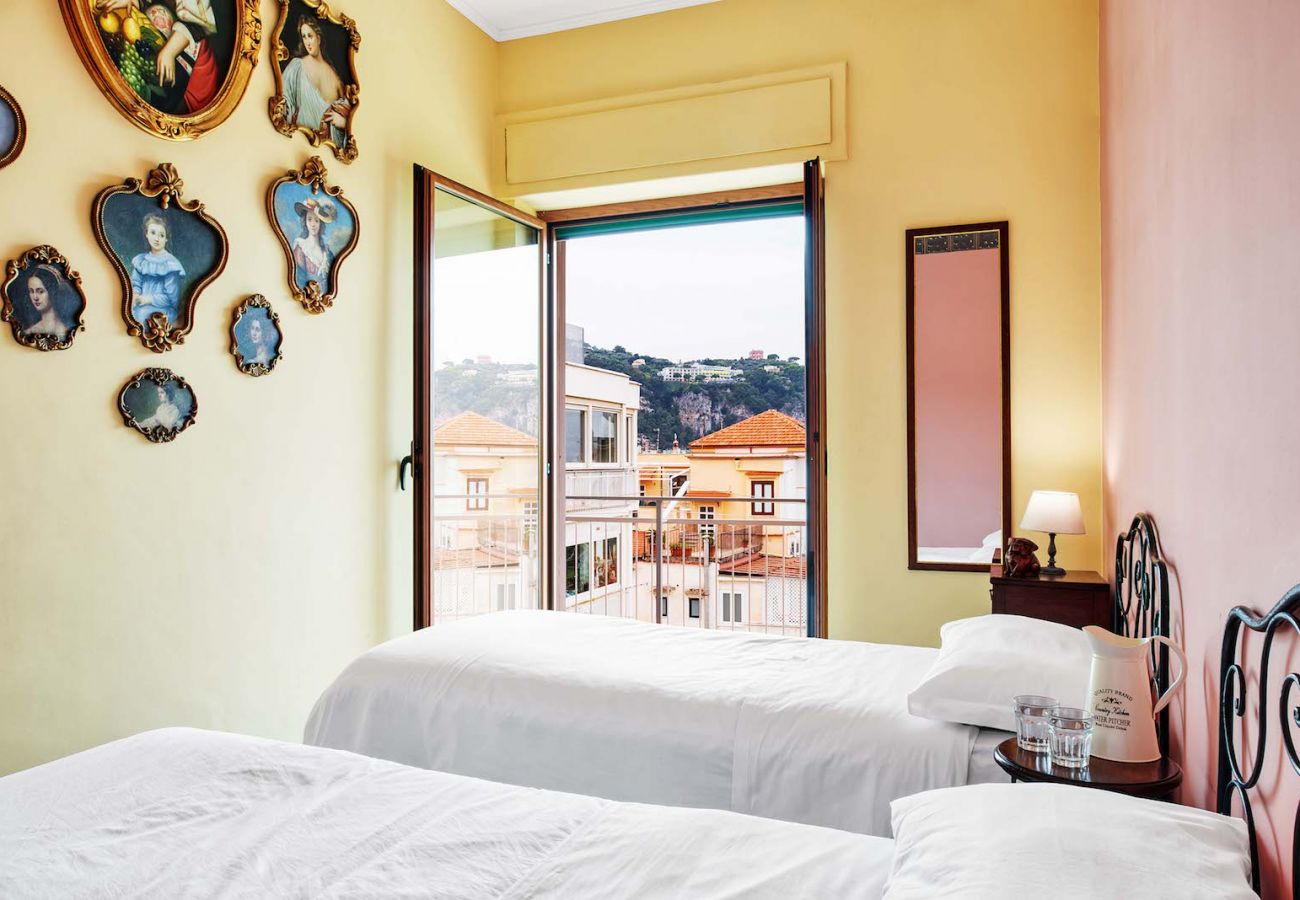 Twin bedroom, pastel yellow, with balcony, sorrento holiday apartment