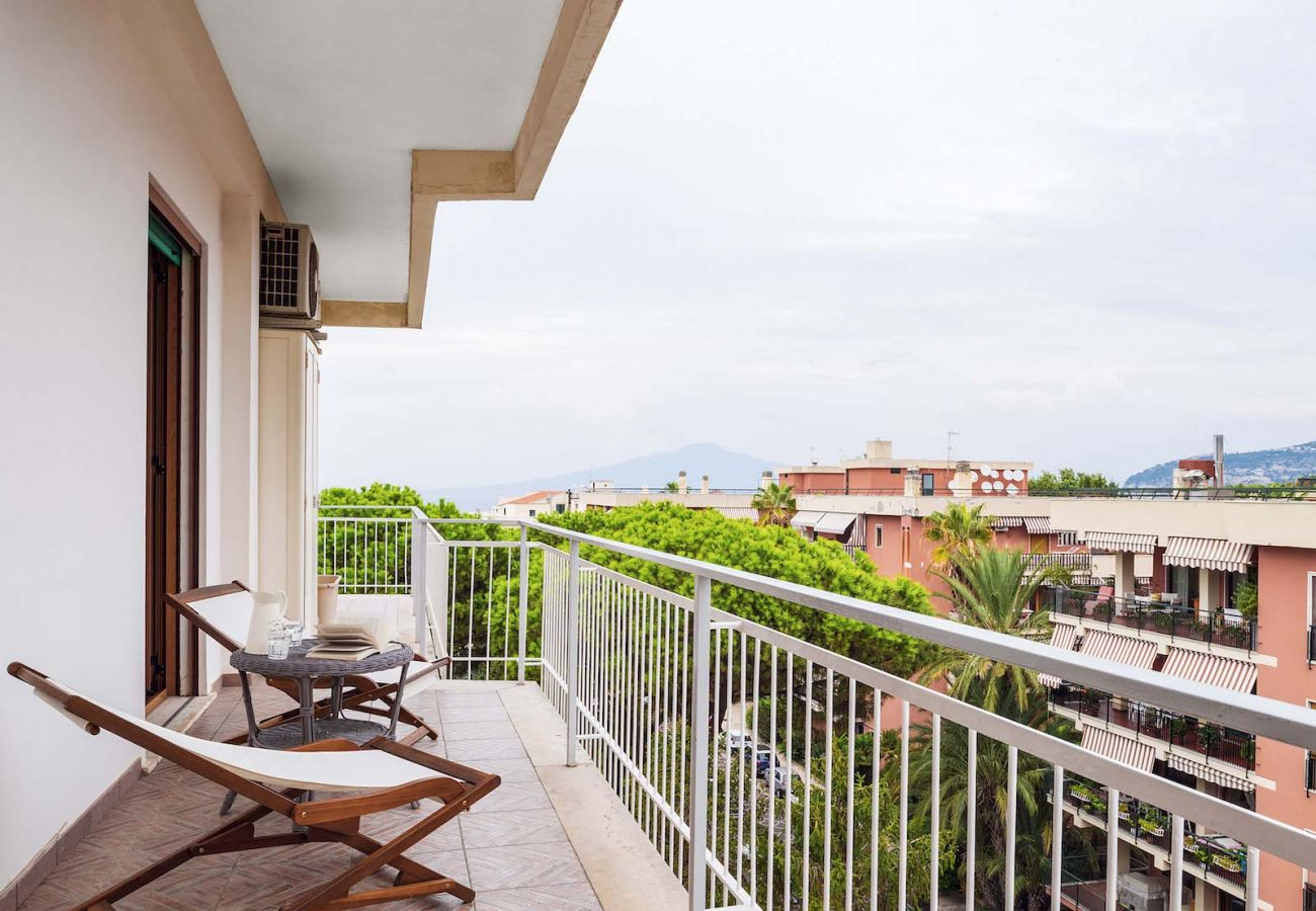 terrace with sunbed, overlooking sorrento city centre, italy