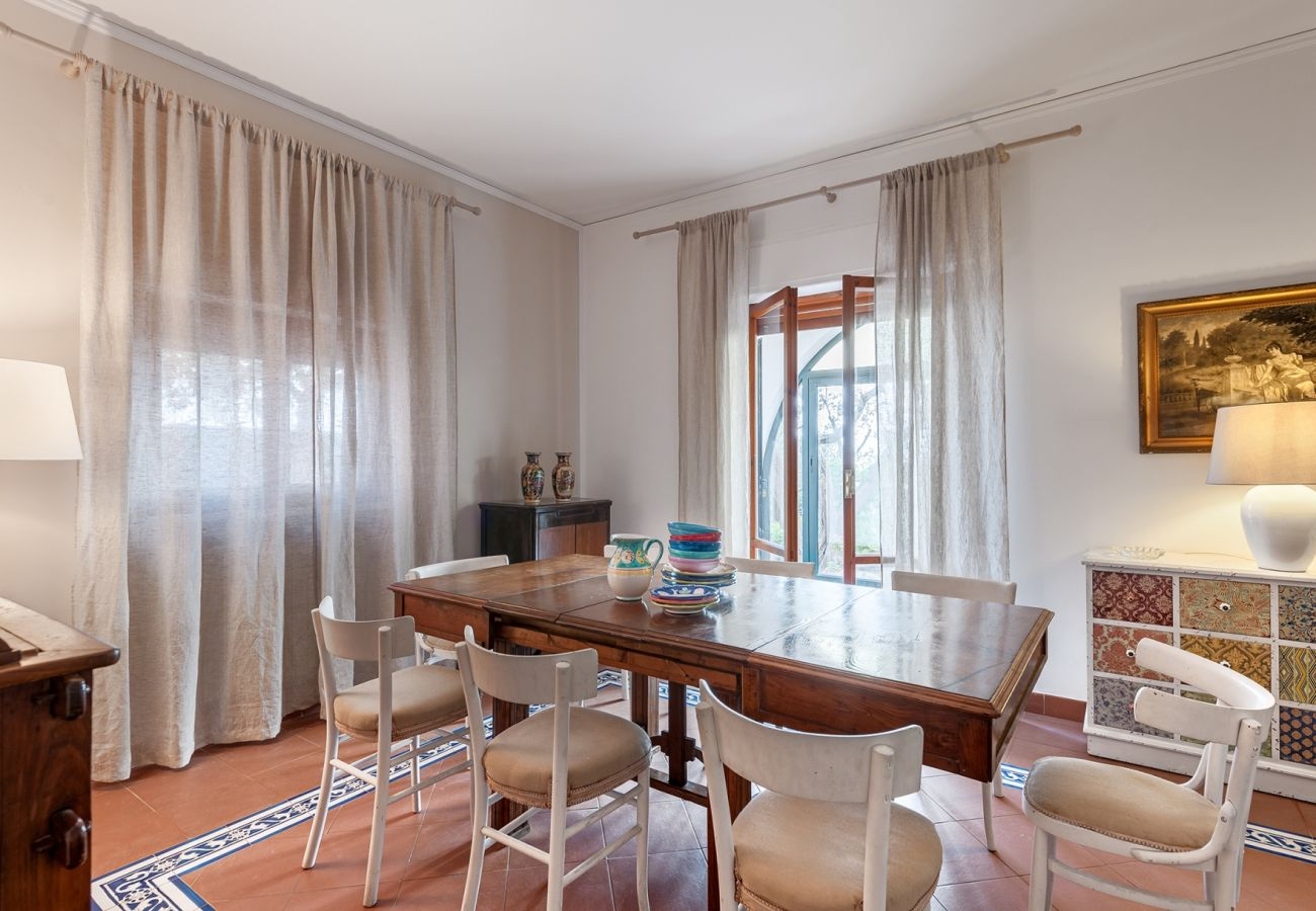 dining area, classic furniture, table and chairs, villa alfonsina, massa lubrense, italy