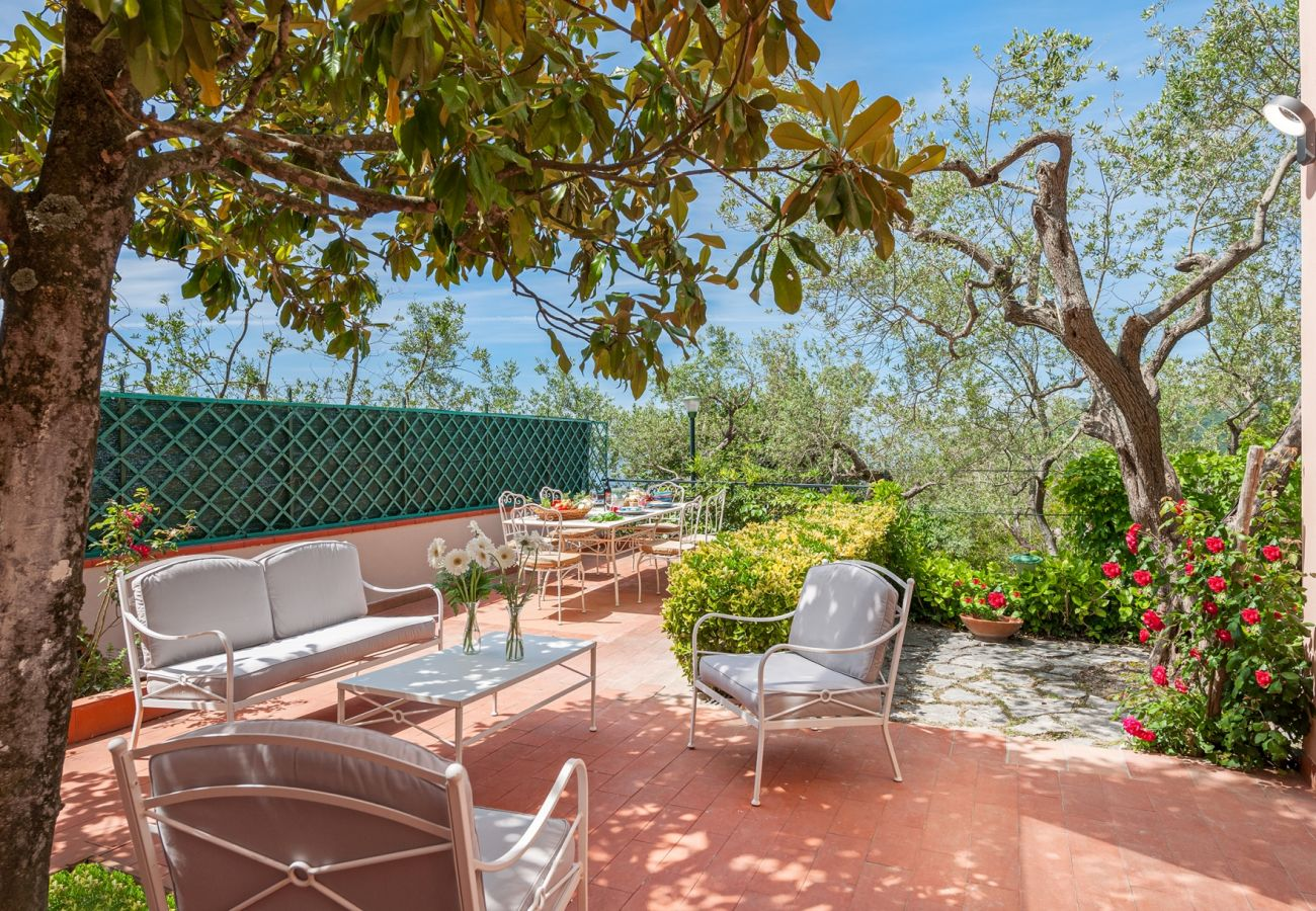 outer patio in a sunny day with table & chairs, villa alfonsina, massa lubrense, italy