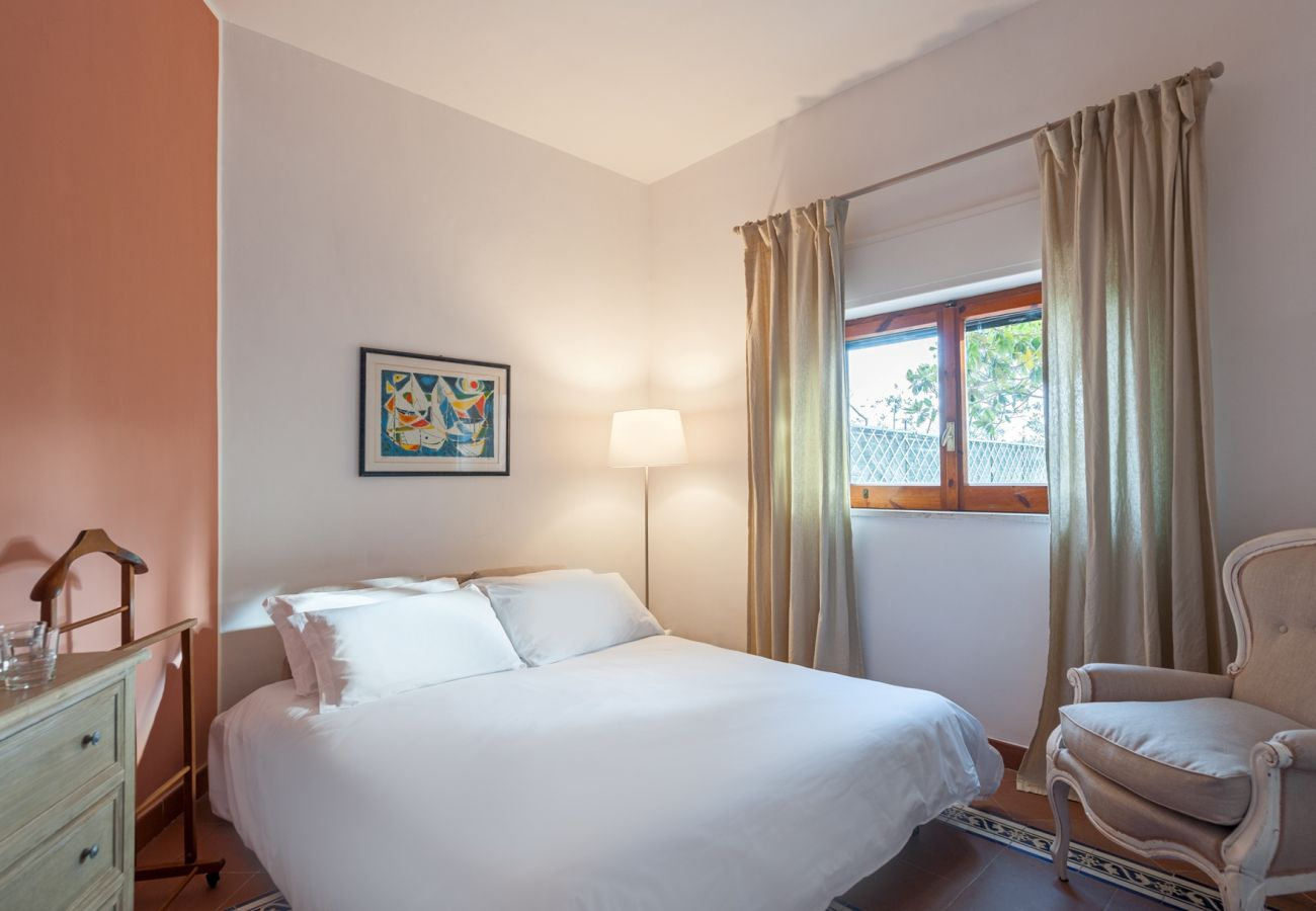 bright double bedroom, soft light, window, villa alfonsina, massa lubrense, italy