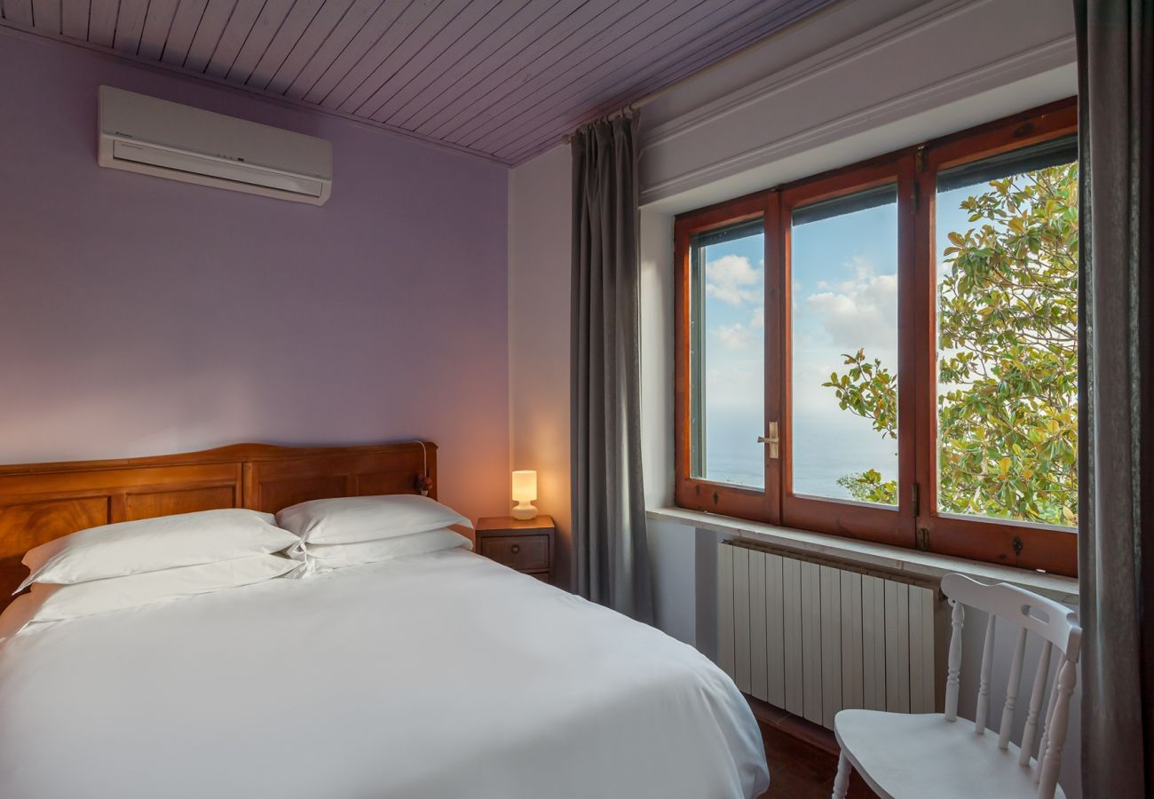 double bedroom with air conditioner and wide window view, villa alfonsina, massa lubrense, italy