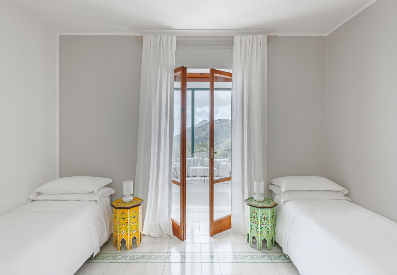bright twin bedroom, veranda access, villa alfonsina, massa lubrense, italy