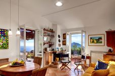 living and dining room with panoramic garden access, vacation villa due golfi, massa lubrense, italy