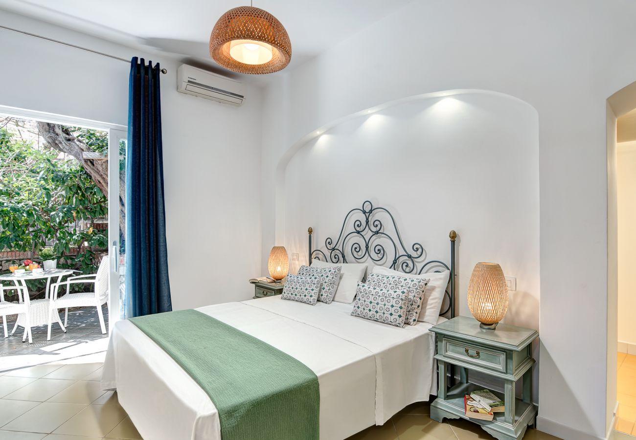 modern double bedroom with opened balcony, holiday villa marinella, nerano, massa lubrense, italy