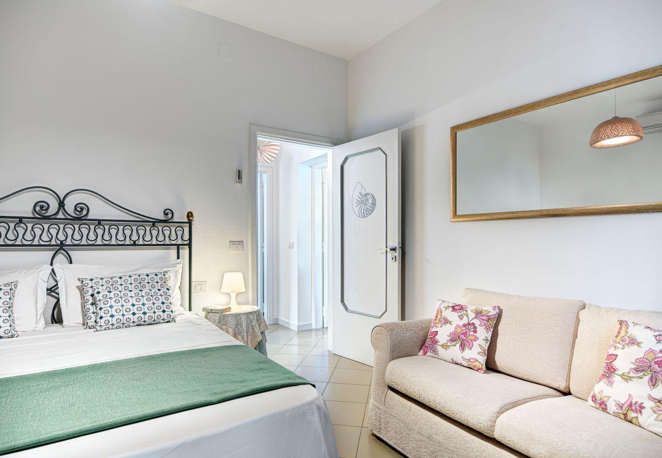 double bedroom with sofa, vacation villa marinella, nerano, massa lubrense, italy