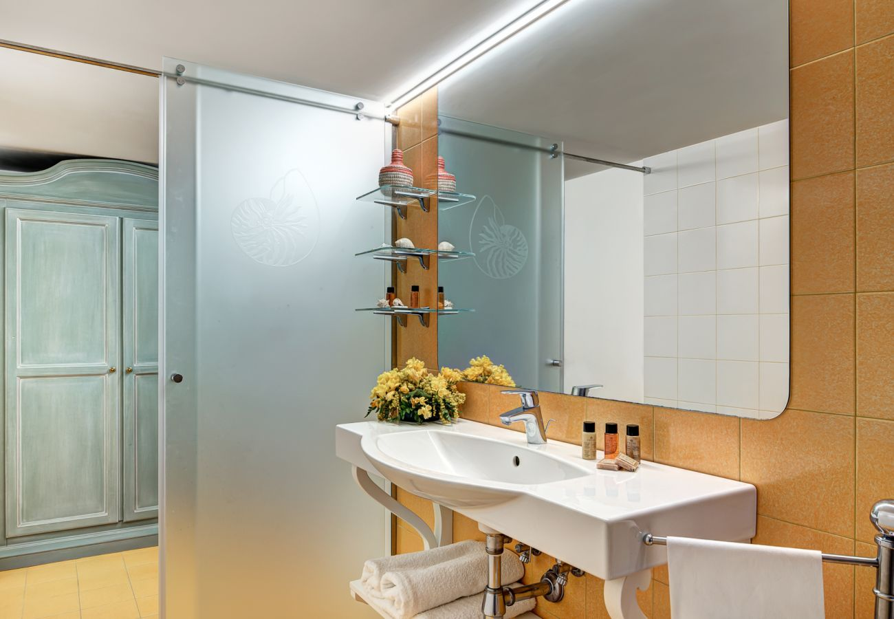 modern orange bathroom, vacation villa marinella, nerano, massa lubrense, italy