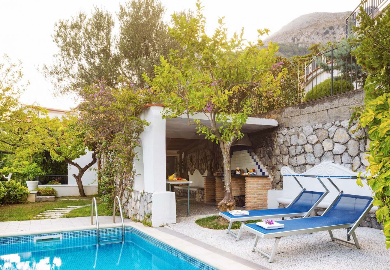 pool side and solarium of private vacation villa in nerano italy
