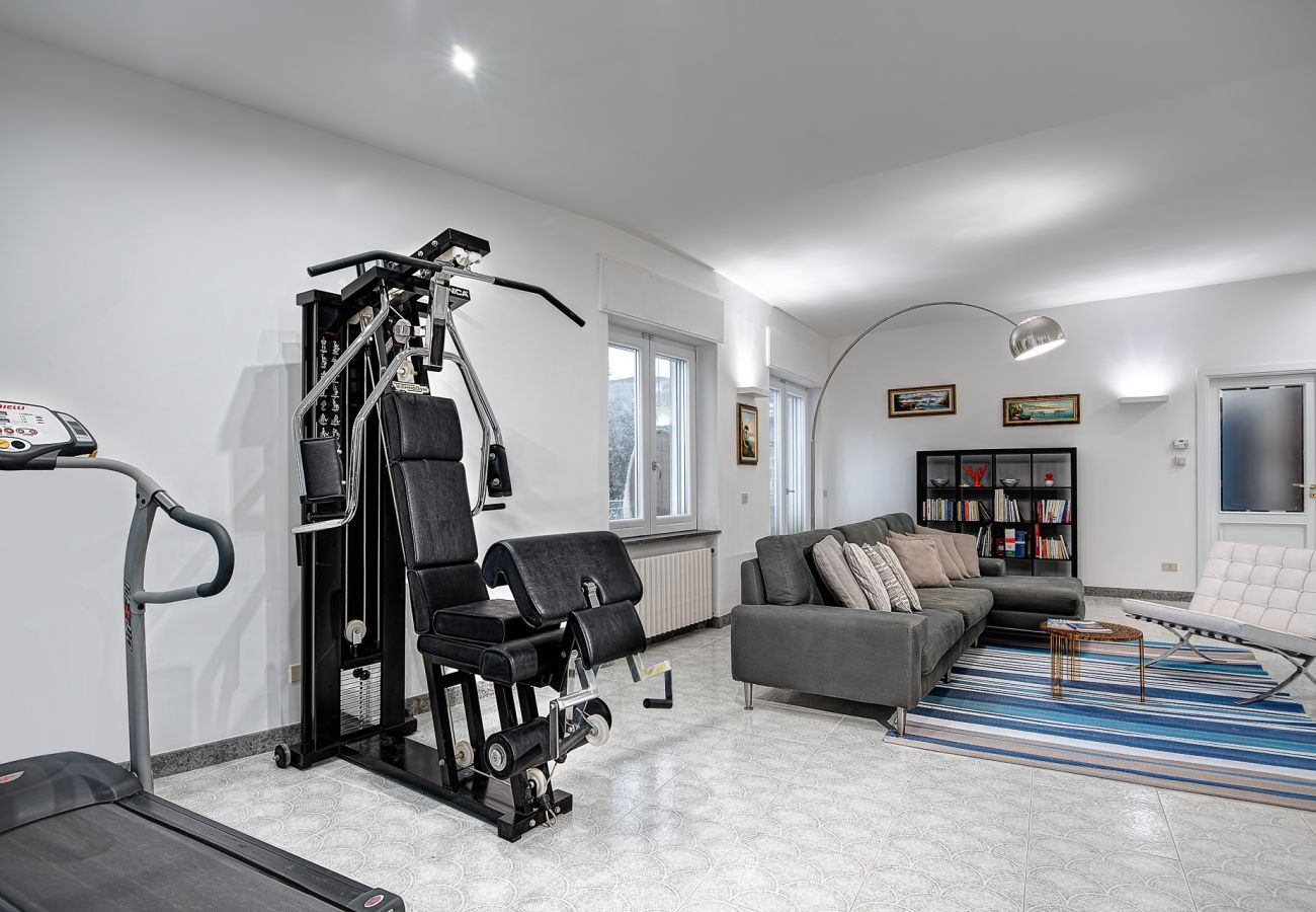 living room with gym equipment area, villa milena, sorrento, italy