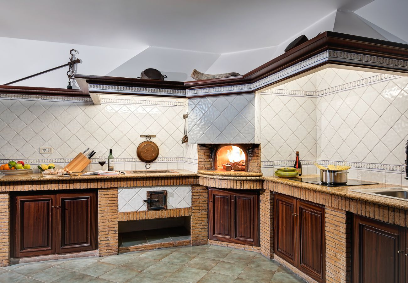 italian kitchen style with wood oven, villa milena, sorrento, italy