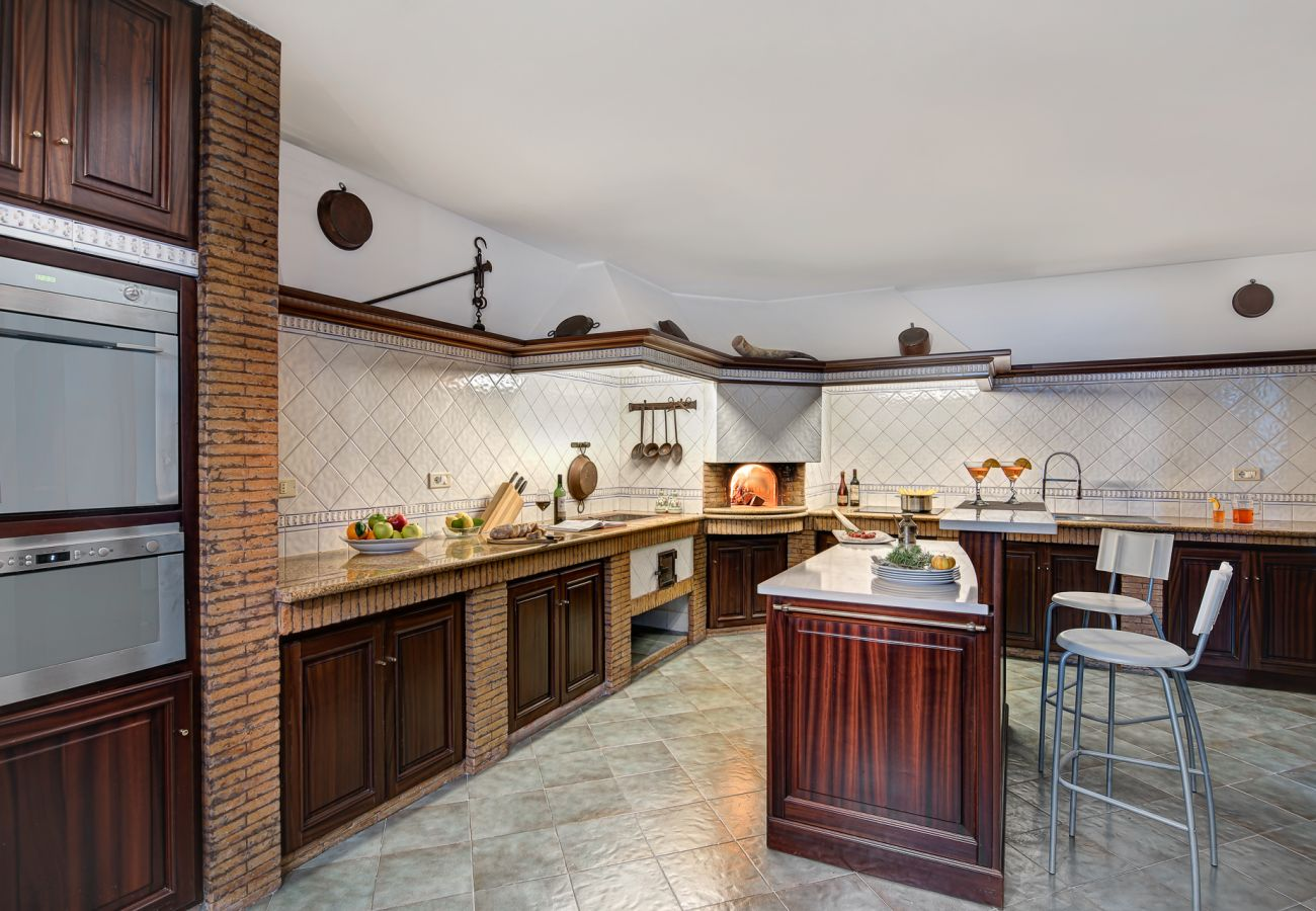wide kitchen italian style with pizza wood oven, villa milena, sorrento, italy