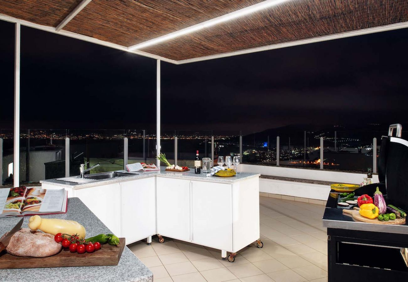 panoramic terrace overlooking sorrento area, at night, with bbq and some food