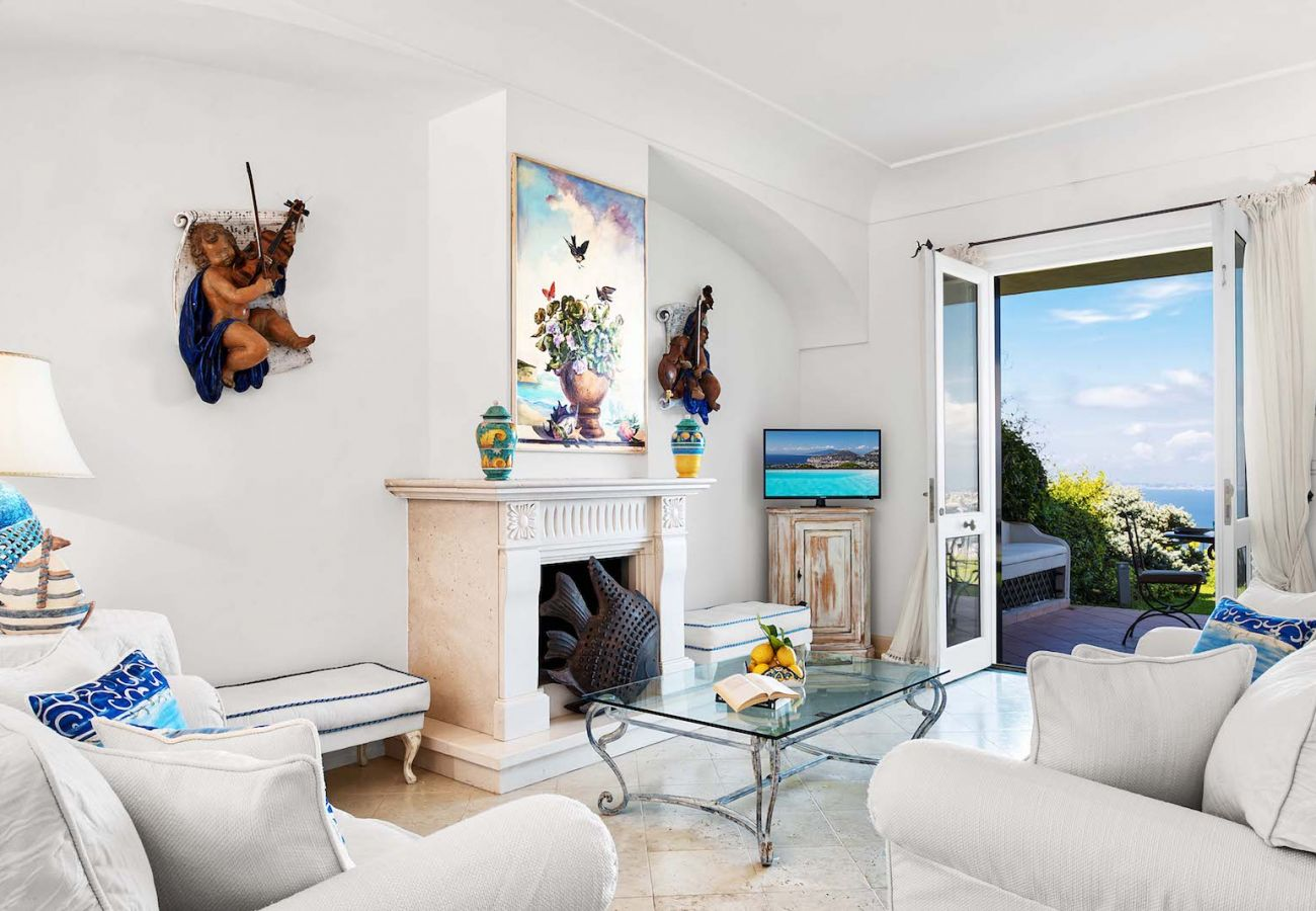 bright living room with opened balcony, vacation villa nana