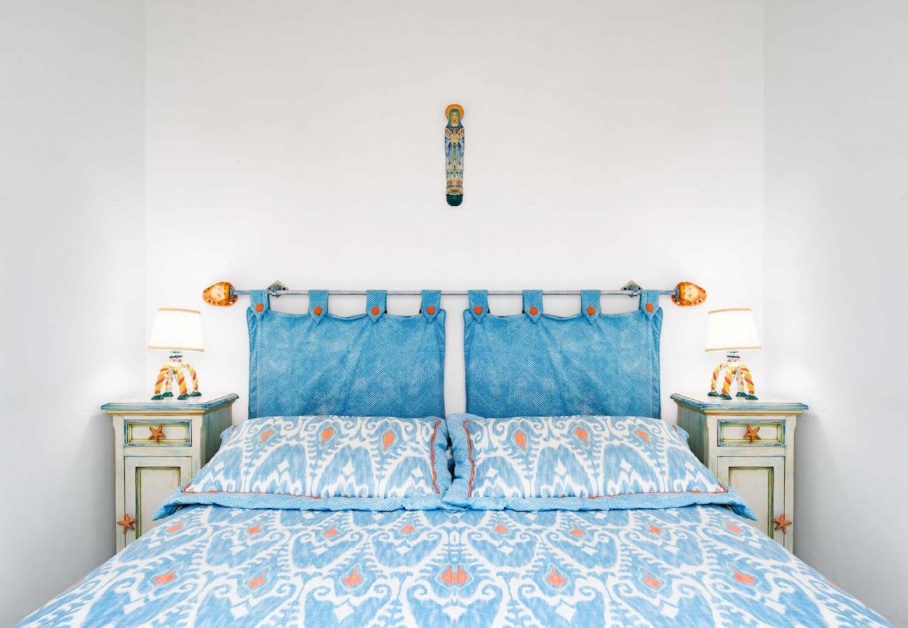 double bed, light blue and white