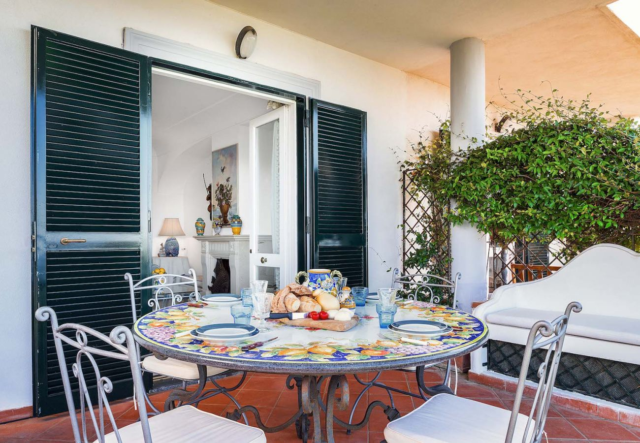 external patio with table and iron chairs, vacation villa nanà