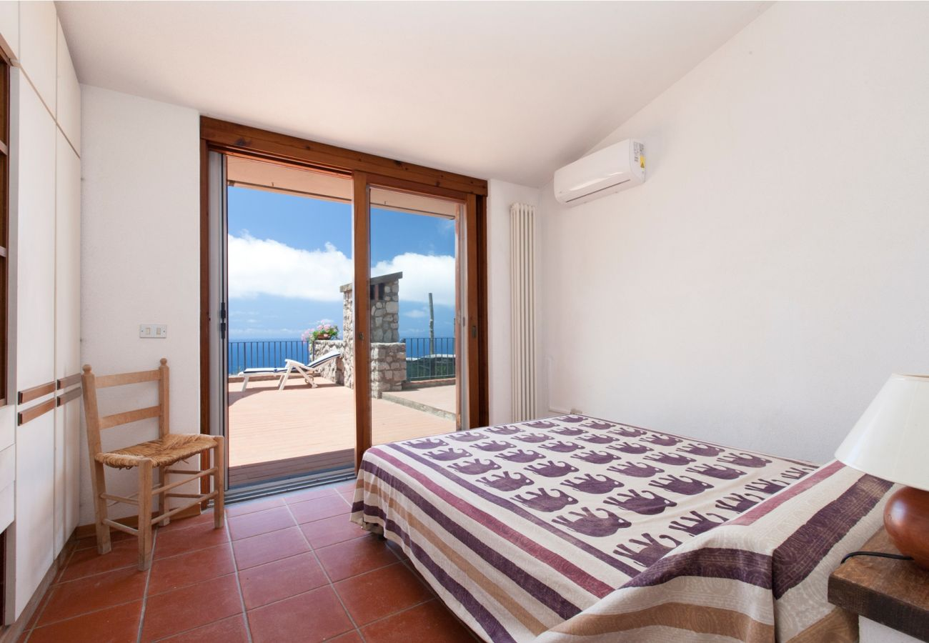 double bedroom with terrace and air conditioner, holiday villa sterlizia, massa lubrense, italy