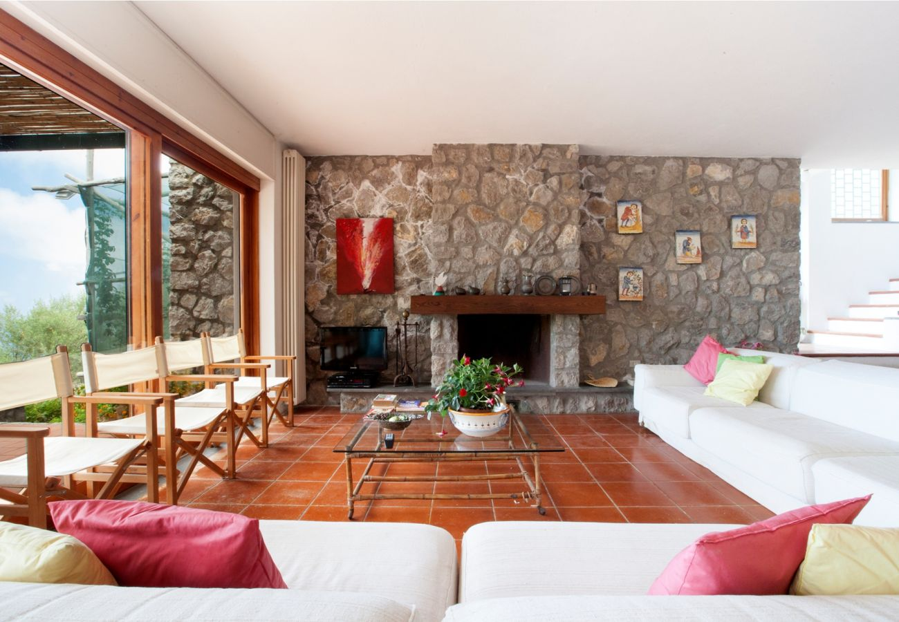 wide bright living area with fireplace, holiday villa sterlizia, massa lubrense, italy